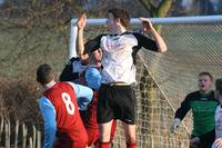 Beccles defender rises but ball hits the bar