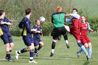 Beccles keeper rushes out