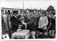 Peter Downing receives the Wortwell Cup from the g