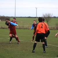 Cawston attacks the ball and the opposition player
