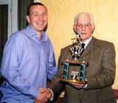 Mark Harvey receiving the POY trophy from Club Pre