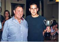 Shaun Flint receiving his award from David Arnold,